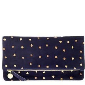 Clare V. Navy and white dot folding clutch